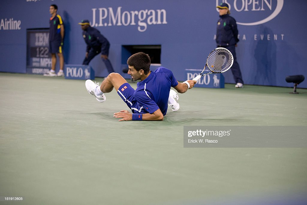Serbia Novak Djokovic on ground during Men's Final vs Great Britain Andy Murray at BJK National Tennis Center. Erick W. Rasco F69 )