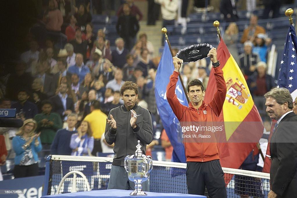 Serbia Novak Djokovic victorious, holding up seond place trophy after match vs Spain Rafael Nadal after Men's Final at BJK National Tennis Center. Erick W. Rasco F16 )