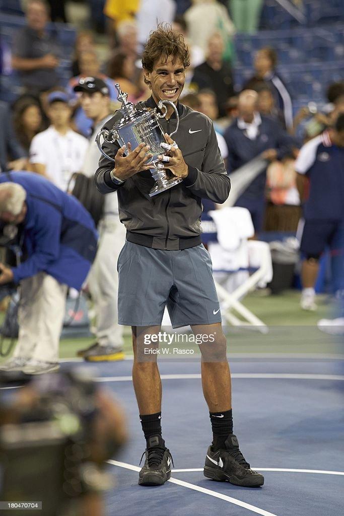 Spain Rafael Nadal victorious, holding US Open Trophy after winning match vs Serbia Novak Djokovic during Men's Final at BJK National Tennis Center. Erick W. Rasco F142 )