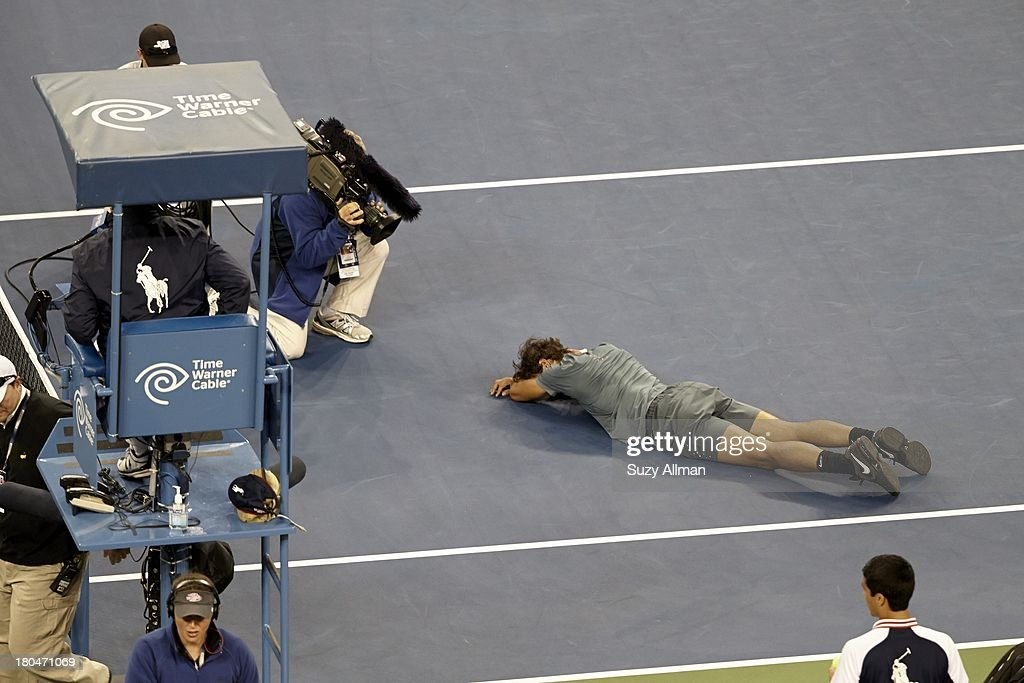 Spain Rafael Nadal victorious, lying on court during celebration after winning Men's Final vs Serbia Novak Djokovic at BJK National Tennis Center. Suzy Allman F83 )