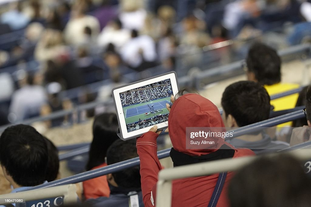View of fan taking photo with iPad during Men's Final between Spain Rafael Nadal and Serbia Novak Djokovic at BJK National Tennis Center. Suzy Allman F49 )