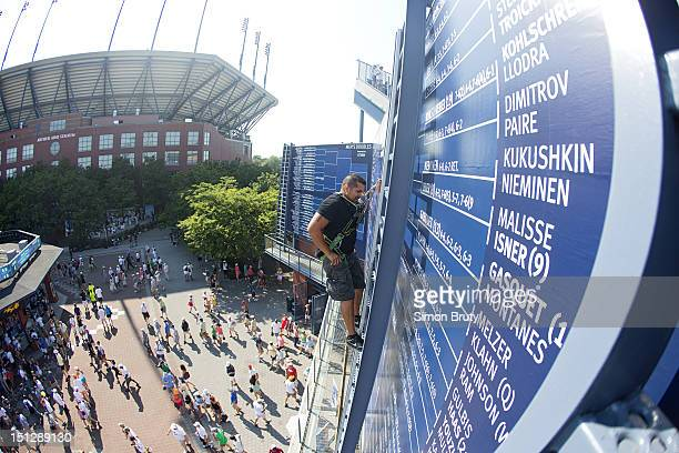 US Open View of Frank Ayala manually updating leader board on ladder during 1st Round at BJK National Tennis Center Drawboard Flushing NY CREDIT...