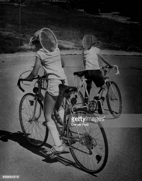 Tennis What A Racket These two Youngsters have found an Unusual way to carry their Tennis Rackets While riding Bicycles to courts at Arvada High...