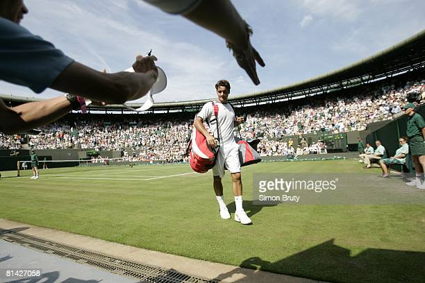 Tennis Wimbledon CHE Roger Federer signing autographs with fans before 2nd round match vs CZE Ivo Minar at All England Club London GBR 6/22/2005