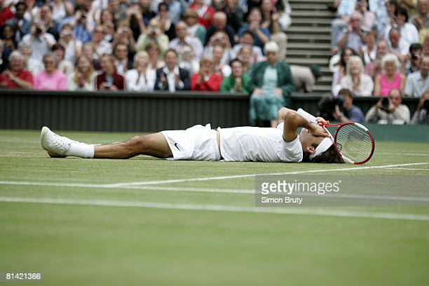 Tennis Wimbledon CHE Roger Federer victorious lying down on court after winning finals match vs USA Andy Roddick at All England Club London GBR...