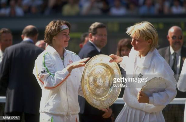 Wimbledon Czech Republic Jana Novotna grabbing Rosewater Dish Switzerland Martina Hingis in jest after losing Women's Final match at All England Club...