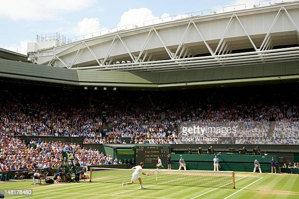 Wimbledon Rear view of Great Britain Andy Murray in action vs Switzerland Roger Federer during Men's Final at All England Club London England...
