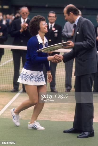 Wimbledon USA Billie Jean King victorious receiving the Rosewater Dish trophy from Prince Phillip after winning Women's Finals match vs Australia...