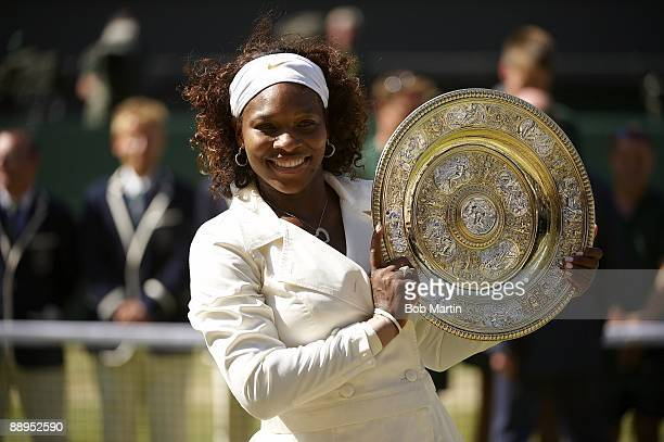 Wimbledon USA Serena Williams victorious with Rosewater Dish trophy after match vs USA Venus Williams during Women's Finals at All England Club...