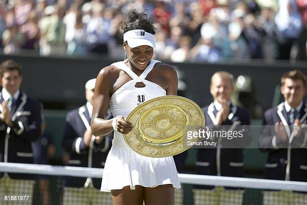 Wimbledon USA Venus Williams victorious with Rosewater Dish trophy after winning Finals match vs USA Serena Williams at All England Club London...