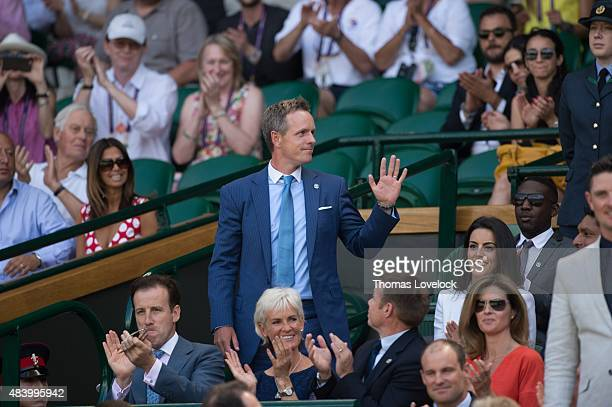 Wimbledon View of golf athlete Luke Donald waving to crowd from Royal Box during Day 6 at All England Tennis Club London England 7/4/2015 CREDIT...