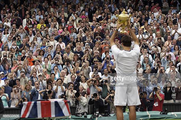 Wimbledon View of victorious fans cheering Switzerland Roger Federer with Gentlemen's Singles Trophy after winning Men's Final vs USA Andy Roddick at...