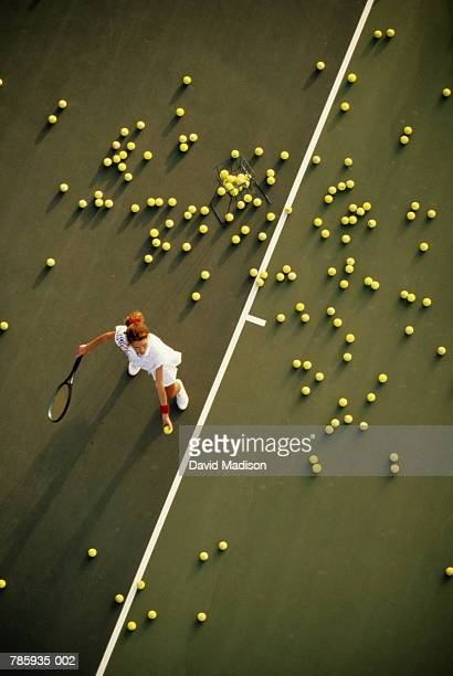 Tennis, woman practising serve, overhead view