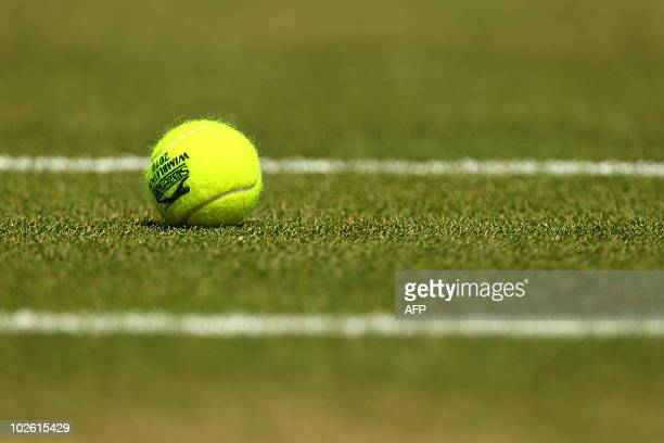 A tennisball is pictured courside during play between Czech player Tomas Berdych and Spanish player Rafael Nadal during the men's singles grand final...