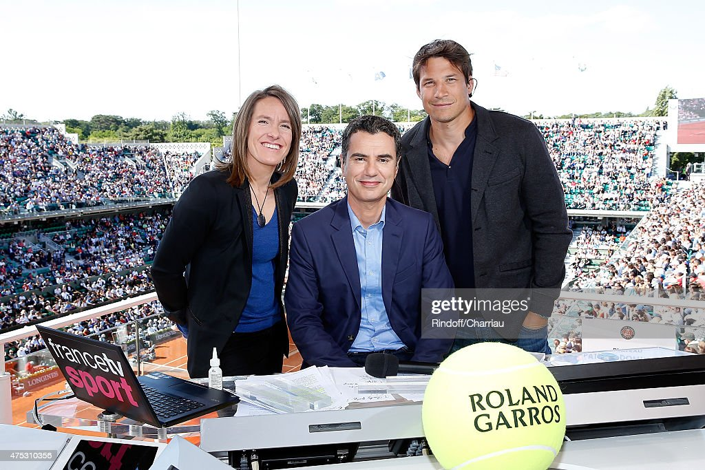 Tenniswoman <a gi-track='captionPersonalityLinkClicked' href=/galleries/search?phrase=Justine+Henin&family=editorial&specificpeople=157479 ng-click='$event.stopPropagation()'>Justine Henin</a>, Sports Journalist Laurent Luyat and Rugbyman <a gi-track='captionPersonalityLinkClicked' href=/galleries/search?phrase=Francois+Trinh-Duc&family=editorial&specificpeople=4209248 ng-click='$event.stopPropagation()'>Francois Trinh-Duc</a> attends the French Tennis Open 2015 at Roland Garros on May 30, 2015 in Paris, France.