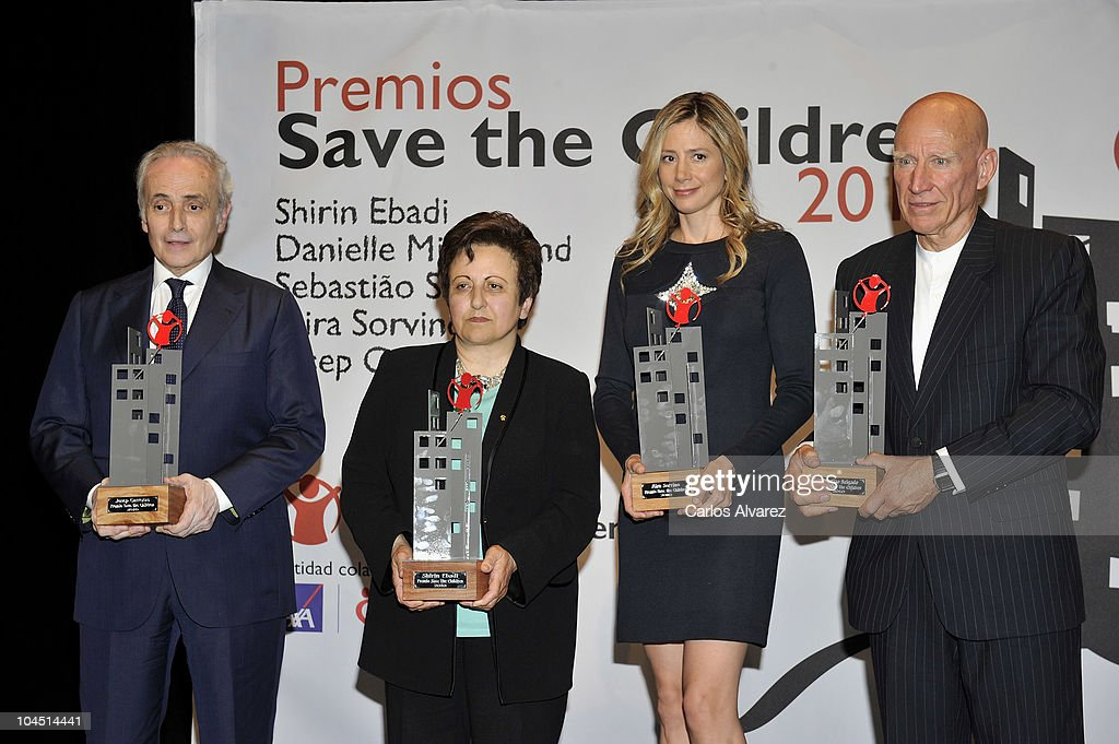 Tenor Jose Carreras, Iranian Nobel Peace Prize <a gi-track='captionPersonalityLinkClicked' href=/galleries/search?phrase=Shirin+Ebadi&family=editorial&specificpeople=563922 ng-click='$event.stopPropagation()'>Shirin Ebadi</a>, actress <a gi-track='captionPersonalityLinkClicked' href=/galleries/search?phrase=Mira+Sorvino&family=editorial&specificpeople=203143 ng-click='$event.stopPropagation()'>Mira Sorvino</a> and Brazilian photographer Sebastiao Salgado pose for the photographers during Save the Children awards ceremony at the Circulo de Bellas Artes on September 28, 2010 in Madrid, Spain.