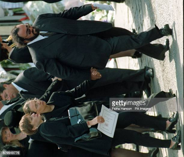 Tenor Luciano Pavarotti with his friend Nicoletta Mantovani and another unidentified friend as they leave Westminster Abbey this morning following...