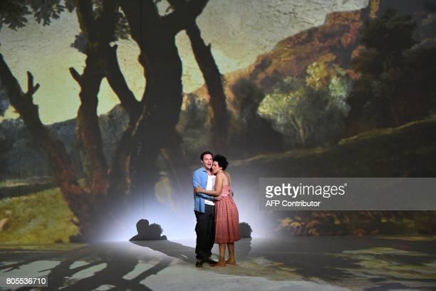 US tenor Paul Appleby as Tom Rakewell and US soprano Julia Bullock as Ann Trulove perform Igor Stravinski's opera 'The Rake's Progress' directed by...