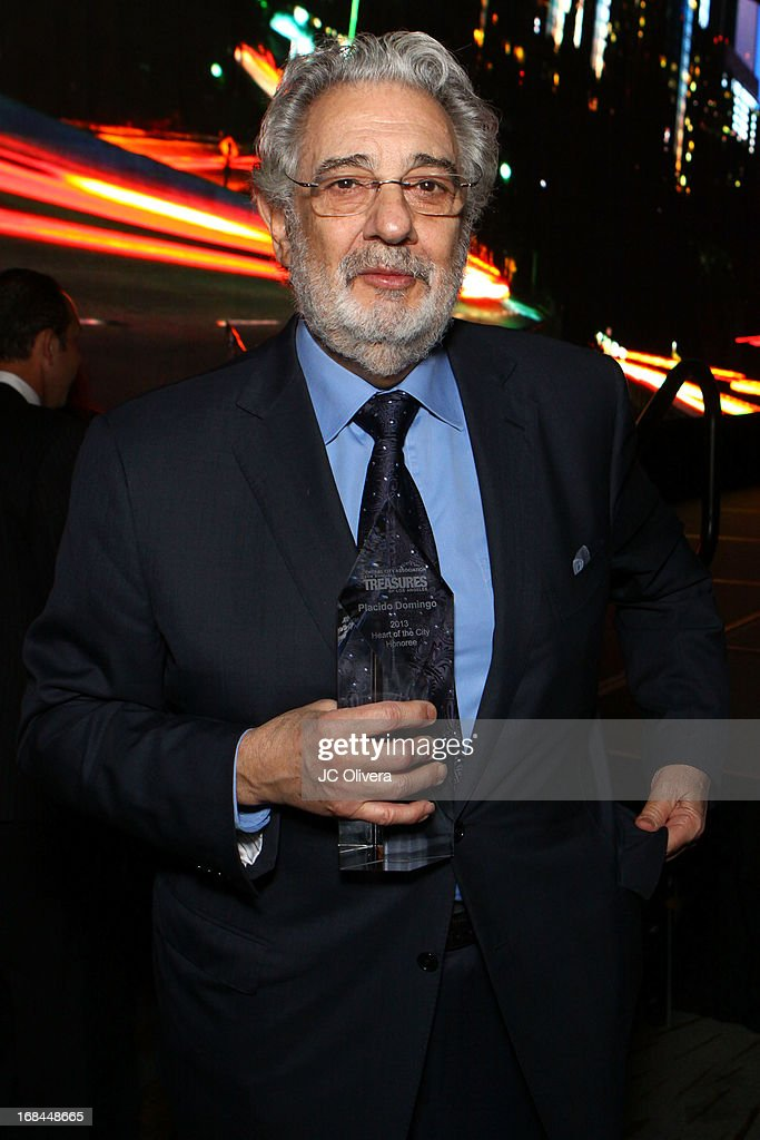 Tenor Placido Domingo poses with his 'Heart of the City Award' during The Central City Association's 19th Annual 'Treasures of Los Angeles' Awards Luncheon honoring Tenor Placido Domingo at Westin Bonaventure Hotel on May 9, 2013 in Los Angeles, California.
