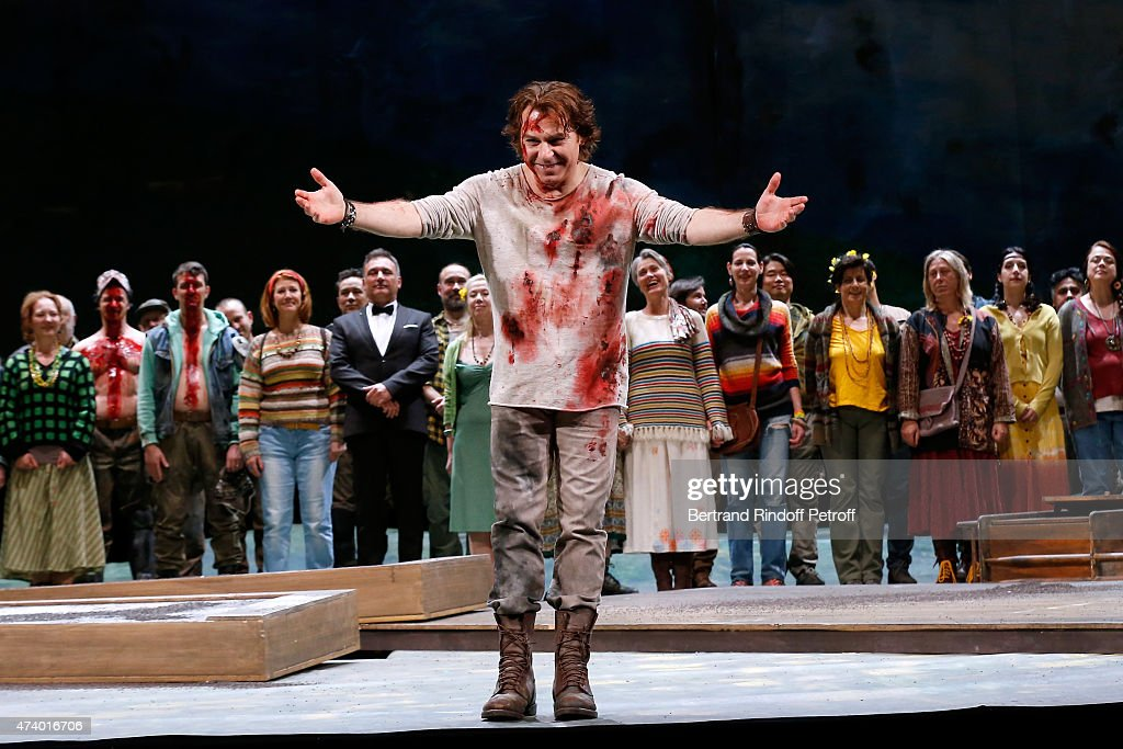 Tenor <a gi-track='captionPersonalityLinkClicked' href=/galleries/search?phrase=Roberto+Alagna&family=editorial&specificpeople=679931 ng-click='$event.stopPropagation()'>Roberto Alagna</a> acknowledges the applause of the audience at the end of the AROP Charity Gala with the Opera 'Le Roi Arthus', Music and Libretto from Ernest Chausson. Held at Opera Bastille on May 19, 2015 in Paris, France.