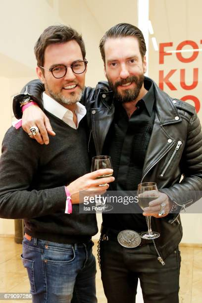 Tenor Tobey Wilson and BossHoss singer Alec Voelkel attend the 'FotoKunstBoulevard' opening at MartinGropiusBau on May 4 2017 in Berlin Germany