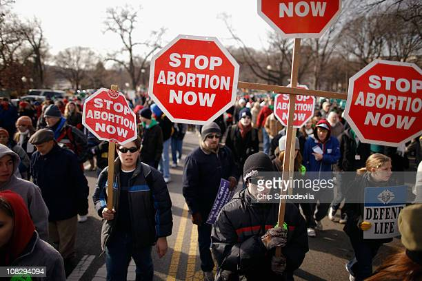 Tens of thousands of antiabortion demonstrators march along Constitution Avenue toward the Supreme Court during the March for Life January 24 2011 in...