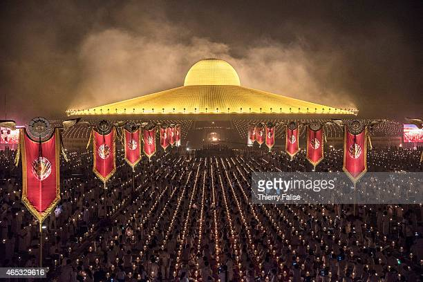 Tens of thousands of Dhammakaya temple's members sit around the socalled Cetiya a large chedi containing one million Buddha images during a mass...