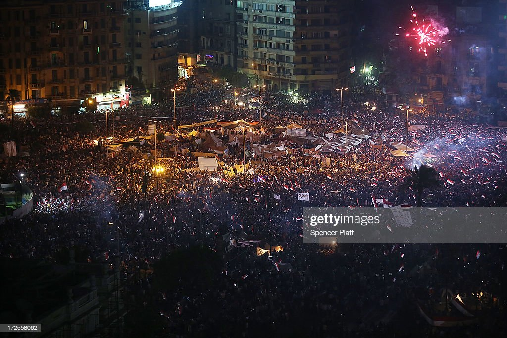 Tens of thousands of Egyptian protesters celebrate in Tahrir Square as the deadline given by the military to Egyptian President Mohammed Morsi passes on July 3, 2013 in Cairo, Egypt. The president gave a defiant speech last night and vowed to stay in power despite the military threats. As unrest spreads throughout the country, at least 23 people were killed in Cairo on Tuesday and over 200 others were injured. It has been reported that the military has taken over the state television.
