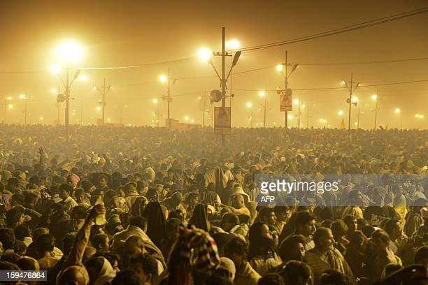 Tens of thousands of Hindu devotees crowd a large field on the banks of the Sangham or confluence of the Yamuna and Ganges rivers as they surge...