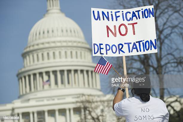 Tens of thousands of immigration reform supporters march in the 'Rally for Citizenship' on the West Lawn of the US Capitol in Washington DC on April...