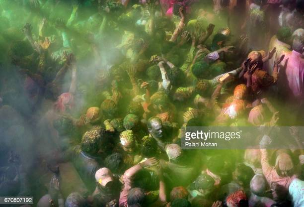 Tens of thousands of Indian celebrate Holi the festival of colours at Sri Nanke Bihari temple on March 22 2008 in Vrindavan India Thousands of...