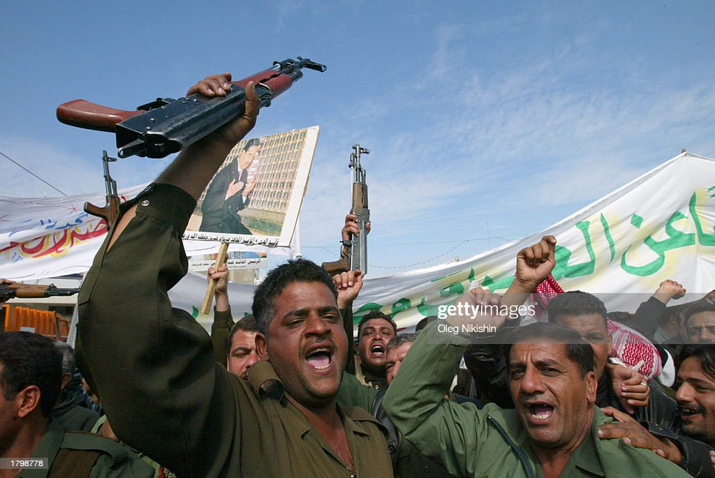 Tens of thousands of Iraqi demonstrate to show support for President Saddam Hussein February 15, 2003 in Baghdad, Iraq. President Saddam Hussein met February 15 with a special envoy of Pope John Paul II as part of international efforts to resolve the possible U.S.-led war against Iraq peacefully, while millions of people around the world gathered in protest against the possibility of war.