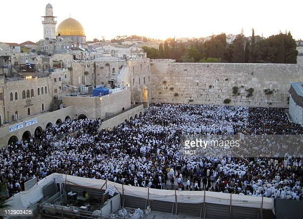 Tens of thousands of Jews gather at the Western Wall in Jerusalem for Shavuot services at sunrise May 29 commemorating the day God gave the Torah to...
