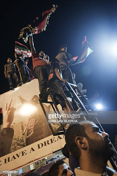 Tens of thousands of Libyans celebrate the arrest of Kadhafi's son Saif alislam and the partial fall of Tripoli in the hands of the Libyan rebels on...
