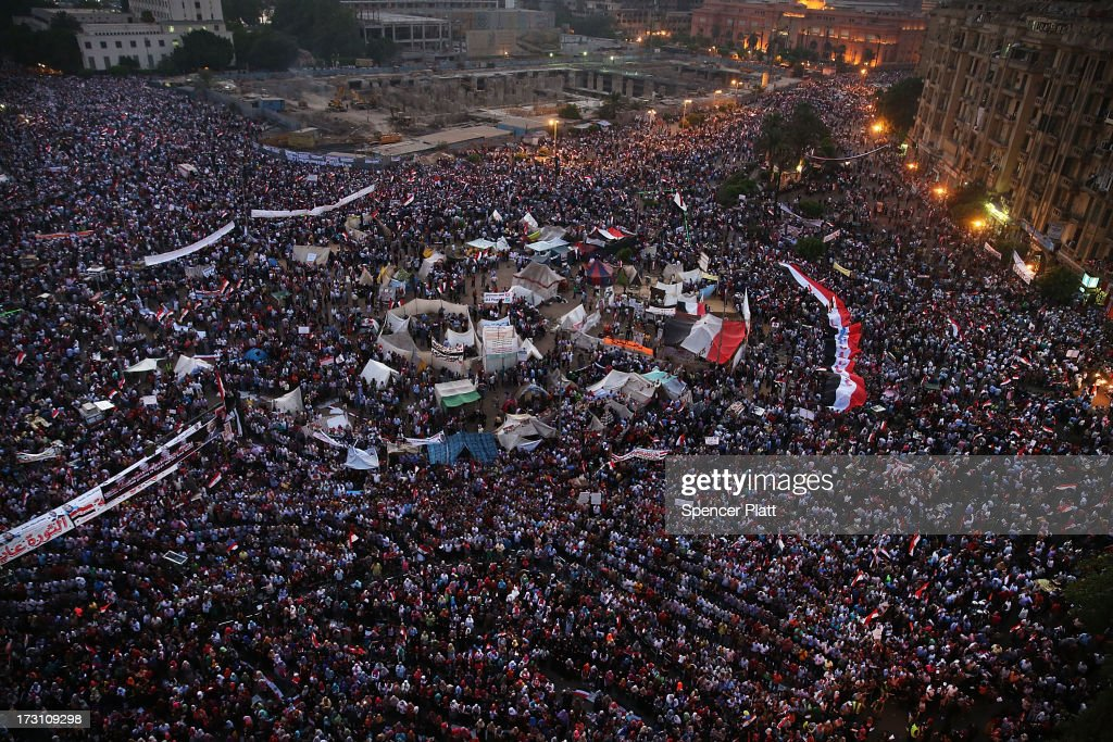 Tens of thousands of people attend a rally in Tahrir Square against ousted Egyptian President Mohamed Morsi on July 7 2013 in Cairo Egypt Egypt...