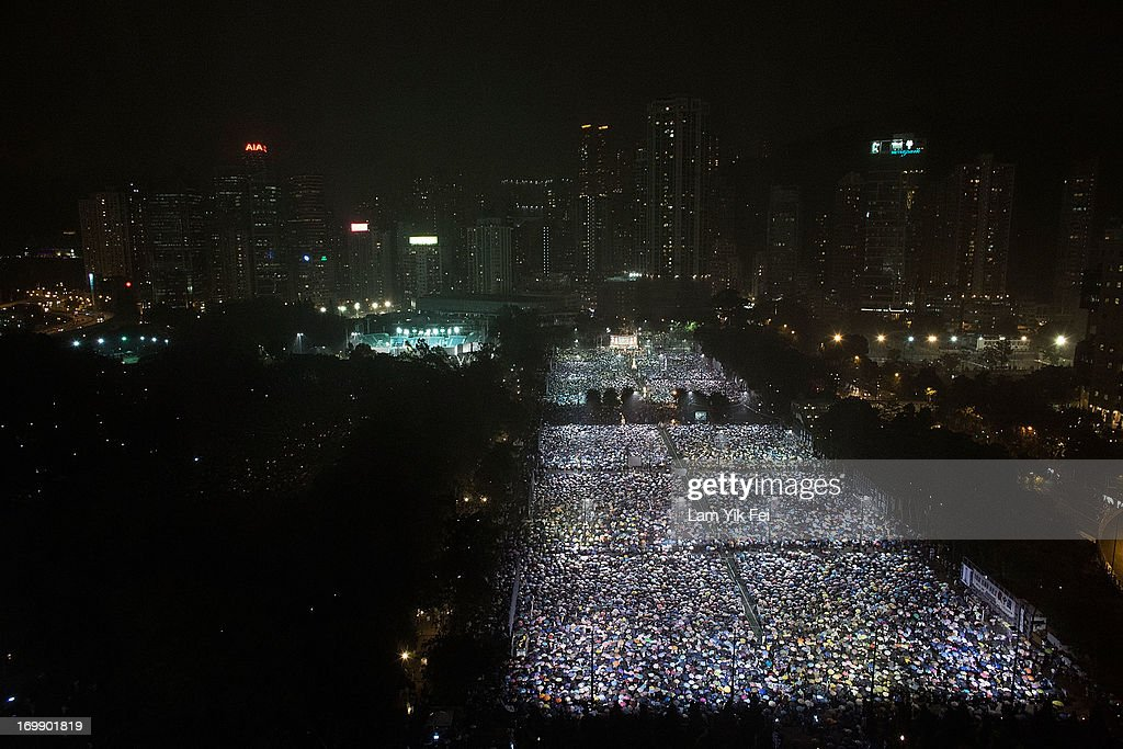Tens of thousands of people take part in a candlelight vigil on the 24th anniversary of the Tiananmen Square protests during heavy rain on June 4, 2013 in Hong Kong, Hong Kong. Held to mark the crackdown on the pro-democracy movement in Beijing's Tiananmen Square on June 4, 1989.Pro-democracy groups hope to draw 150,000 people to the annual candlelight vigil in Hong Kong's Victoria Park, the only commemoration on Chinese soil.