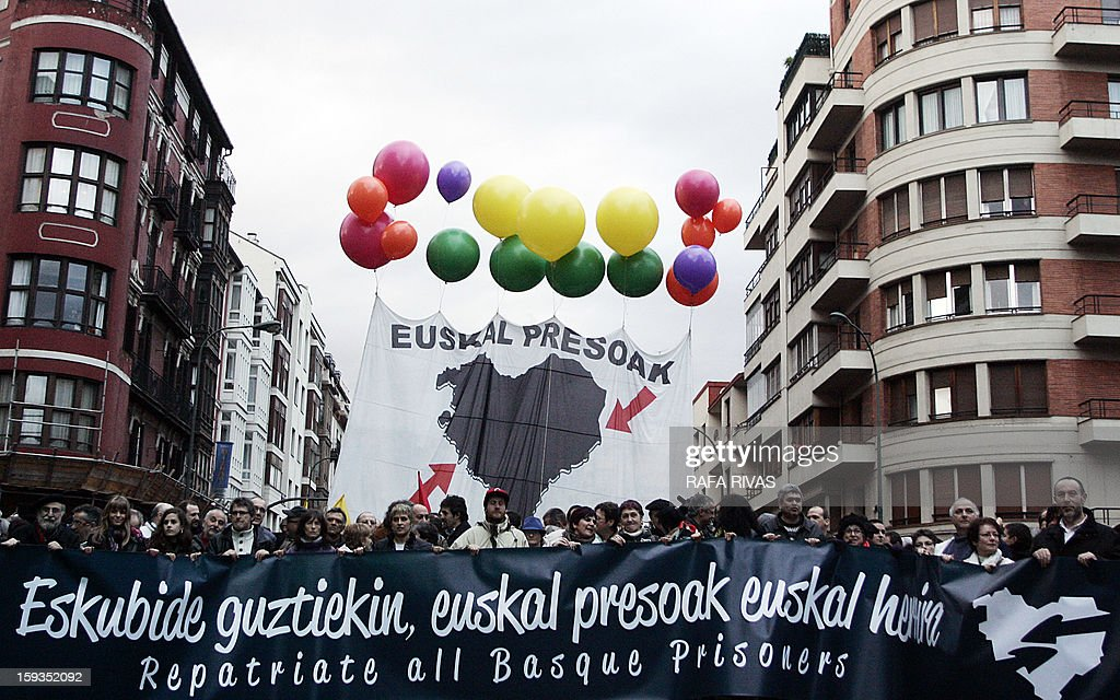 Tens of thousands of people take part in a march demanding the transfer of ETA prisoners to the Basque country during a demonstration called by 'Herrira!' a pro-prisoners group in the Northern Spanish Basque city of Bilbao on January 12, 2013.