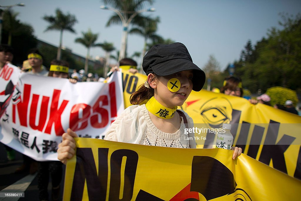 Tens of thousands of protesters rally to show their request to shutting down the island's nuclear power plants during an anti-nuclear rally on March 9, 2013 in Taipei, Taiwan.Tens of thousands of protesters took to the streets in Taiwan calling on the government to shut down the island's nuclear power plants, citing the painful lesson of Japan's nuclear crisis after 9.0-magnitude earthquake two years ago.
