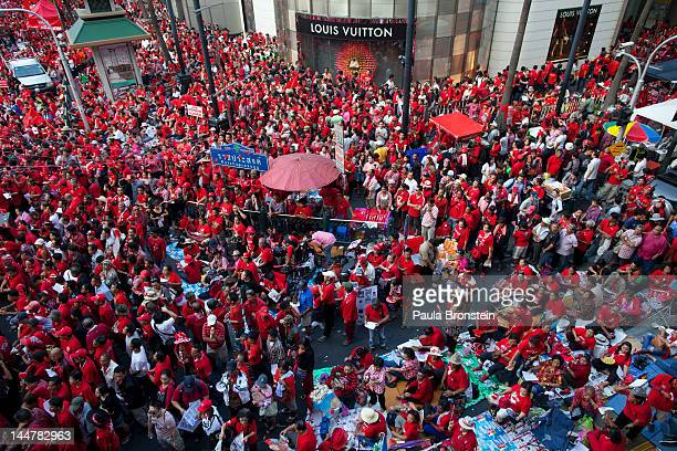 Tens of thousands of red shirts cheer during a rally to commemorate the second anniversary of the violent government crackdown May 19 2012 in...