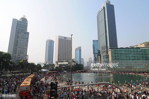 Tens of thousands of residents from across the capital come to the center of the city to jog bike walk or simply enjoy the capitals wide street Car...