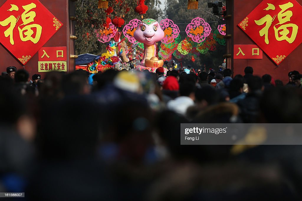 Tens of thousands of residents walk under a snake sculpture at the Spring Festival Temple Fair for celebrating Chinese Lunar New Year of Snake at the Temple of Earth park on February 12, 2013 in Beijing, China. The Chinese Lunar New Year of Snake also known as the Spring Festival, which is based on the Lunisolar Chinese calendar, is celebrated from the first day of the first month of the lunar year and ends with Lantern Festival on the Fifteenth day.
