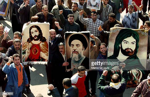 Tens of thousands of Shiite Muslims march peacefully with portraits of Shiite leader AlSistani Jesus and the Imam Hussain to demand an elected...