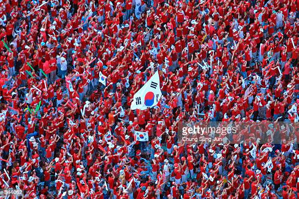 Tens of thousands of South Korean soccer fans gather to watch a telecast of the World Cup semifinal match between South Korea and Germany June 25...