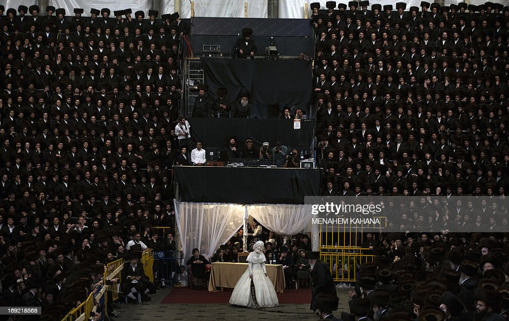 Tens of thousands of Ultra-Orthodox Jews of the Belz Hasidic Dynasty watch the wedding ceremony of Rabbi Shalom Rokach, the Grandson of the Belz Rabbi to Hana Batya Pener, in Jerusalem in the early hours of May 22, 2013. Some 25,000 Ultra-Orthodox Jews participated in one of the biggest weddings in the past few years. AFP PHOTO/MENAHEM KAHANA