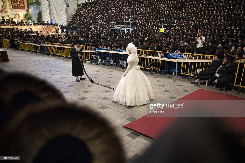 Tens of thousands of Ultra-Orthodox Jews of the Belz Hasidic Dynasty watch the the bride Hannah Batya Penet dances with her relative during the wedding ceremony of Rabbi Shalom Rokach, the Grandson of the Belz Rabbi to Hana Batya Pener, early morrning of May 22, 2013. in Jerusalem, Israel. Some 25,000 Ultra-Orthodox Jews participated in one of the biggest weddings of the of Ultra-Orthodox Jewish community in the past few years.