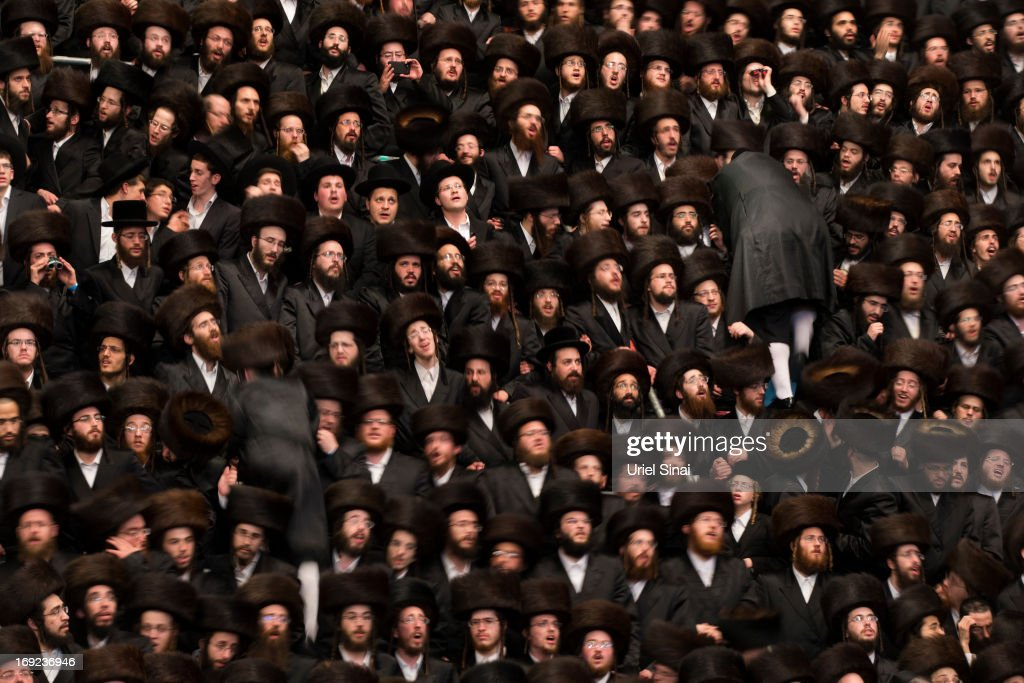 Tens of thousands of Ultra-Orthodox Jews of the Belz Hasidic Dynasty take part in the wedding ceremony of Rabbi Shalom Rokach, the Grandson of the Belz Rabbi to Hana Batya Pener, early morrning of May 22, 2013. in Jerusalem, Israel. Some 25,000 Ultra-Orthodox Jews participated in one of the biggest weddings of the of Ultra-Orthodox Jewish community in the past few years.