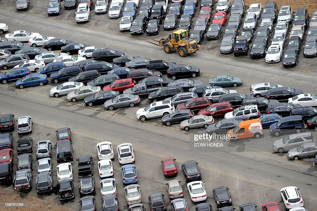Tens of thousands of vehicles damaged by super storm Sandy are being temporarily stored on runways and taxiways at Calverton Executive Airpark in Calverton, New York, on January 9, 2013 in this aerial view. Insurance Auto Auctions Inc, a salvage auto auction company specializing in total-loss vehicles, acquired the cars and trucks that were damaged, destroyed or flooded by the storm and needed a place to store them. The company made a deal with the Town of Riverhead to lease the airport land and then the vehicles are auctioned online. AFP PHOTO/Stan HONDA
