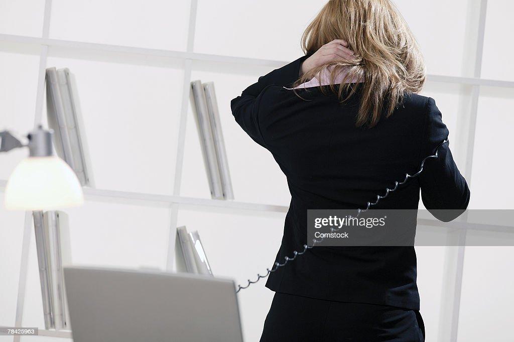 Tense businesswoman on phone : Stock Photo