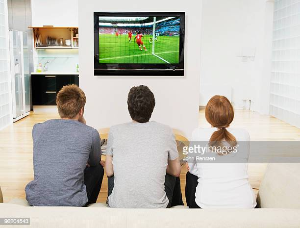 tense fans watch world cup football on television