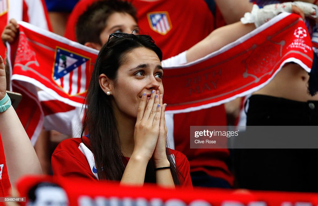 Tension is seen on the face of an Atletico de Madrid fan prior to the UEFA Champions League Final match between Real Madrid and Club Atletico de Madrid at Stadio Giuseppe Meazza on May 28, 2016 in Milan, Italy.